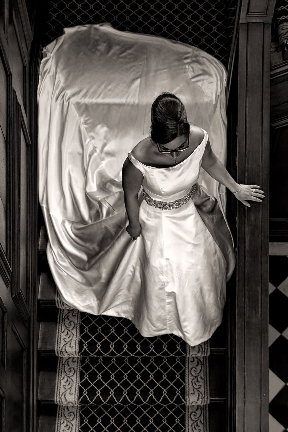 Bride on stairs at St Giles House Norwich